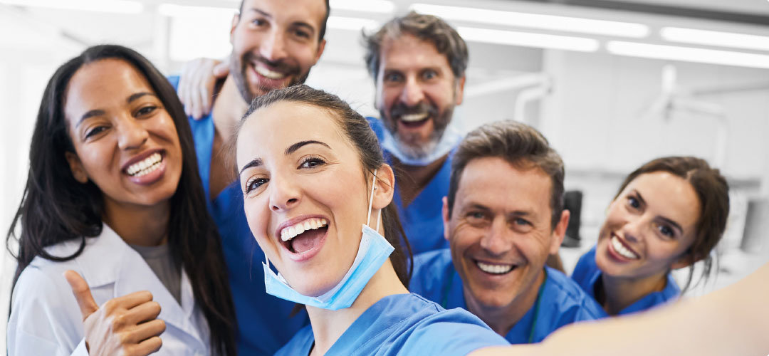 Happy dental team gathers for a selfie photo